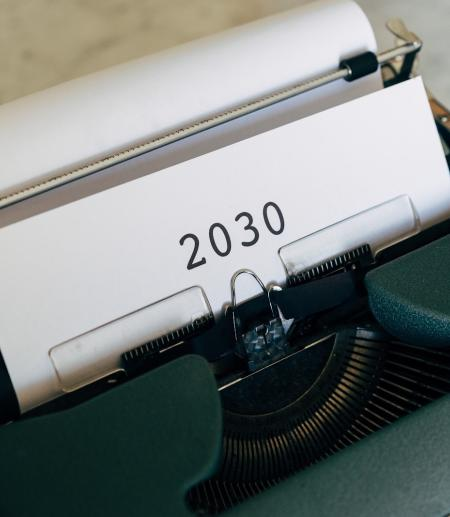 Typewriter with sheet of paper saying 2030