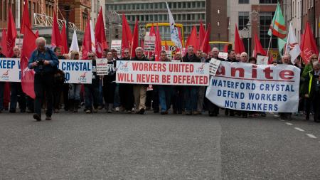 "Protest in Dublin city center, people with large banners that read ""workers united will never be defeated"""