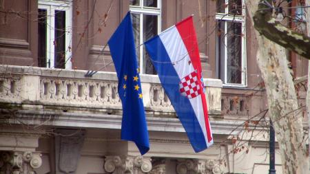 Croatian and EU flags hanging on a building