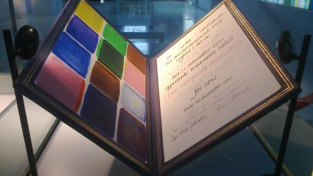 EU Nobel Peace Prize, a large folder with colors on the left and certificate on the right